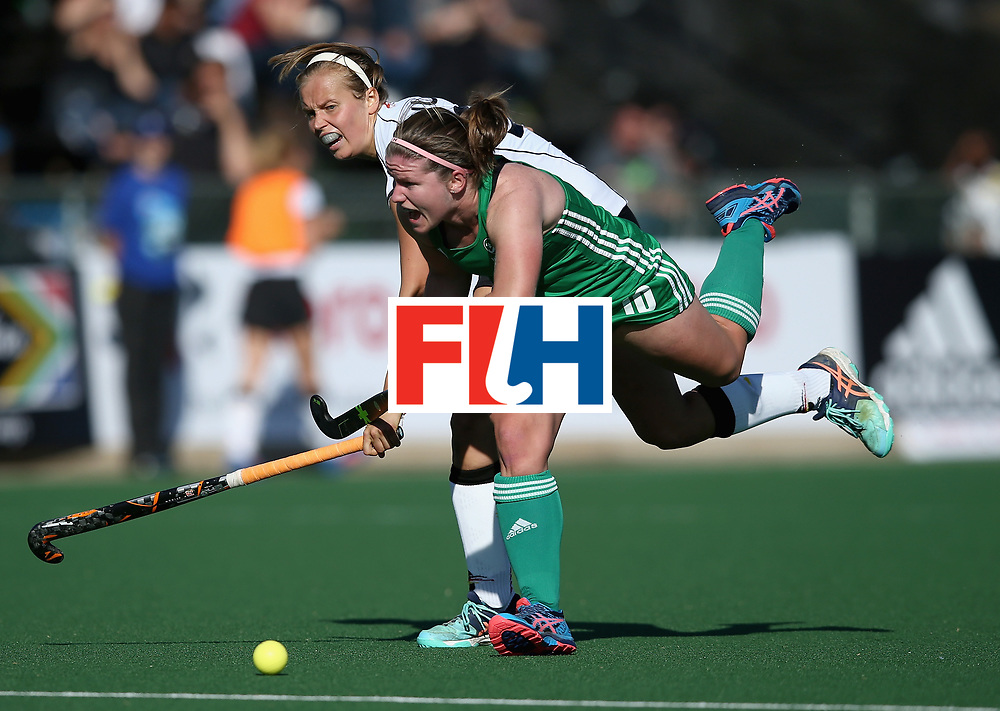 JOHANNESBURG, SOUTH AFRICA - JULY 10: Viktoria Huse of Germany and Shirley McCay of Ireland battle for possession  during day 2 of the FIH Hockey World League Semi Finals Pool A match between Germany and Ireland at Wits University on July 10, 2017 in Johannesburg, South Africa. (Photo by Jan Kruger/Getty Images for FIH)