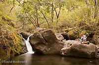 Making dinner along a tropical stream on the Kalalau trail, Napali Coast, Kauai.