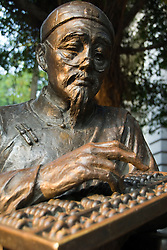 Bronze statue of colonial merchant on Shamian Island in Guangzhou in China