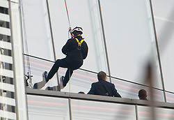 © London News Pictures. 03/09/2012. London, UK.  Prince Andrew reaching the bottom of his descent.  Prince Andrew, The Duke of York abseiling down The Shard building in Central London on September 3, 2012. The Prince joined Ffion Hague billionaire John Caudwell and a team of 37 others to take part in a charity abseil down London's tallest building to raises funds for The Outward Bound Trust and the Royal Marines Charitable Trust Fund. Photo credit: Ben Cawthra/LNP