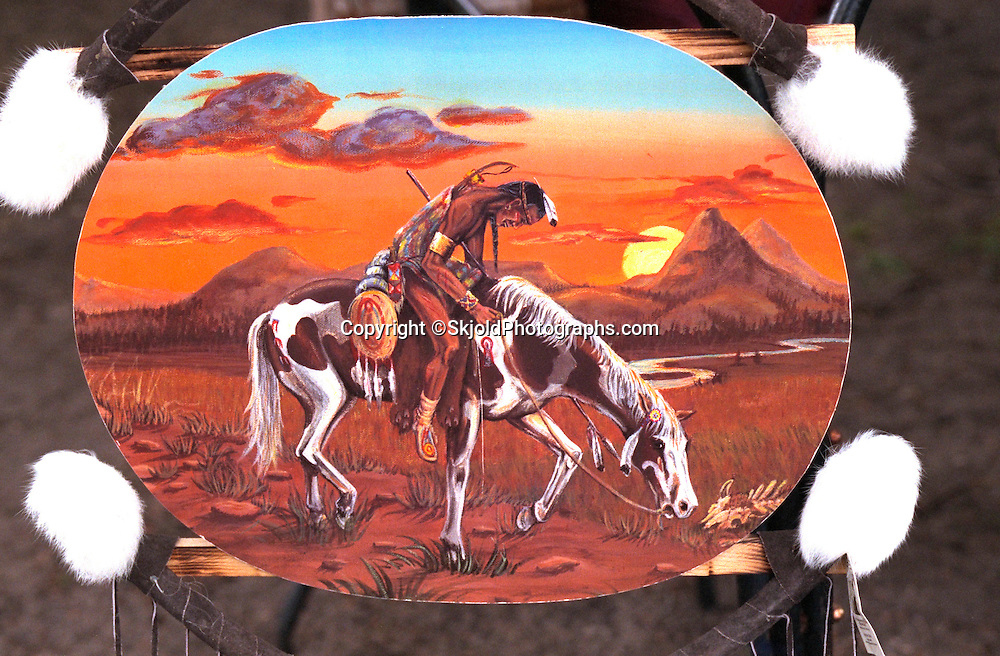 Painting of Indian warrior age 30 resting on his painted horse for sale at flea market.  Battle Lake Minnesota USA