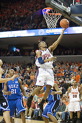 Virginia's Sean Singletary (44) scores two of his 17 points against Duke.  The University of Virginia Cavaliers beat the #8 ranked Duke University Blue Devils 68-66 in overtime at the John Paul Jones Arena in Charlottesville, VA on February 1, 2007...