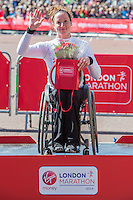 Tatyana McFadden of the USA, winner of the Women's Wheelchair race on the podium after the Women's Wheelchair race at the Virgin Money London Marathon 2014 at the finish line on Sunday 13 April 2014<br /> Photo: Dillon Bryden/Virgin Money London Marathon<br /> media@london-marathon.co.uk