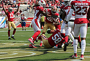 Oct 07, 2018; Santa Clara, CA, USA; San Francisco 49ers running back Matt Breida (22) scores a touchdown on a 5-yard pass in a game between the San Francisco 49ers and the Arizona Cardinals at Levi's Stadium. Arizona defeated San Francisco 28-18. (Spencer Allen/Image of Sport)