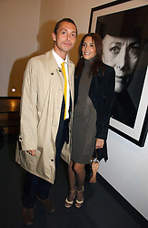 DAN MACMILLAN and  ASTRID MUNOZ at a private view of an exhibition of portrait photographs by Danish photographer Marc Hom held at the Hamiltons Gallery, 13 Carlos Place, London on 23rd October 2006.<br />