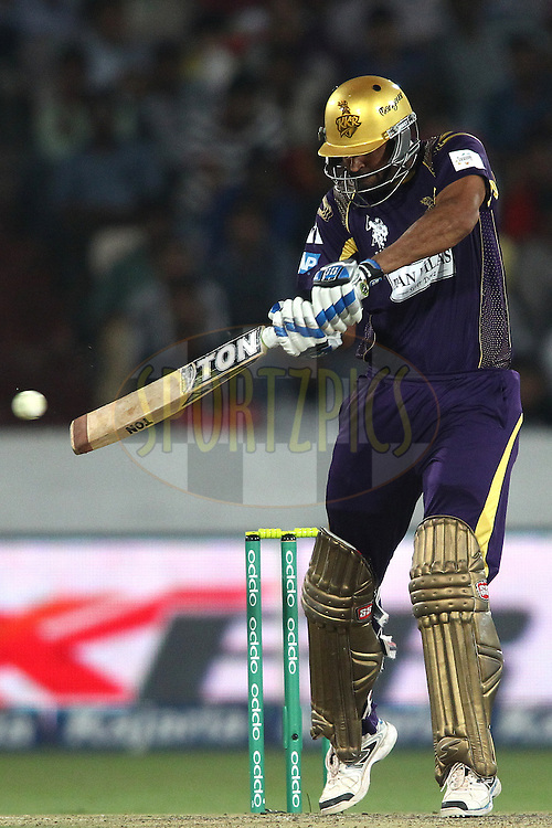 Yusuf Pathan of the Kolkata Knight Riders square cuts a delivery during the first semi final match of the Oppo Champions League Twenty20 between the Kolkata Knight Riders and the Hobart Hurricanes held at the Rajiv Gandhi Cricket Stadium, Hyderabad, India on the 2nd October 2014<br /> <br /> Photo by:  Shaun Roy / Sportzpics/ CLT20<br /> <br /> <br /> Image use is subject to the terms and conditions as laid out by the BCCI/ CLT20.  The terms and conditions can be downloaded here:<br /> <br /> http://sportzpics.photoshelter.com/gallery/CLT20-Image-Terms-and-Conditions-2014/G0000IfNJn535VPU/C0000QhhKadWcjYs