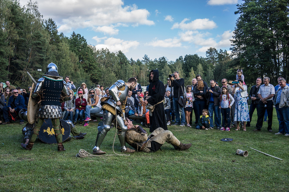 A skit involving men dressed in medieval costumes during a hunting festival near the Augustów Canal on Saturday, September 17, 2016 in Grodno, Belarus.
