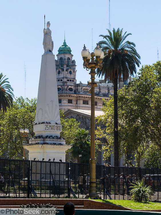 In Plaza de Mayo, the May Pyramid (Pirámide de Mayo, built in 1811) is a monument to commemorate the first anniversary of the May Revolution of 1810, which led to the Argentina's independence from Spain in 1816. Plaza de Mayo is the main square in Monserrat barrio (neighborhood) of central Buenos Aires, in Argentina, South America. Plaza de Mayo took its modern form in 1884 but has been at the political center of Buenos Aires since the city's foundation in 1580. La Revolución de Mayo was a week-long series of events that took place from May 18 to 25, 1810, in Buenos Aires, capital of the Viceroyalty of the Río de la Plata, a Spanish colony that included roughly the territories of present-day Argentina, Bolivia, Paraguay, and Uruguay