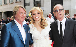 © Licensed to London News Pictures. 01/07/2013. London, UK. Rick Parfitt; Laura Aikman; Francis Rossi Bula Quo UK film premiere, Odeon West End cinema Leicester Square, London. Photo credit: Richard Goldschmidt/LNP