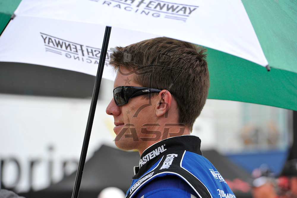Brooklyn, MI - JUN 17, 2012: Carl Edwards (99) waits in the rain before race action for the Quicken Loans 400 race at the Michigan International Speedway in Brooklyn, MI.