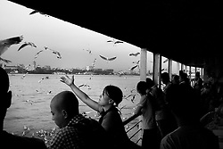 A child on the ferry boat that connects the city of Yangon with the Dala township, across the Yangon river. At Dala, Yangon Division, Myanmar, 16th February, 2014.