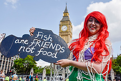 © Licensed to London News Pictures. 02/09/2017. London, UK.  Vegans and other demonstrators take part in an Animal Rights march from Hyde Park Corner to Parliament Square demanding an end to animal oppression in order to help the planet.  Photo credit : Stephen Chung/LNP