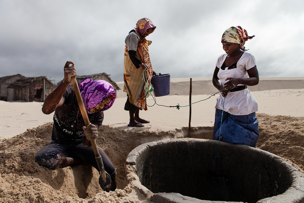 In a village of traditional fishers in southwest Madagascar, women dig away sand from a well that relentless winds had started covering over.  Climate change will increase the intensity of cyclones here; but also make rainfall more erratic and drought more severe.  Fishers don't migrate just because of climate change, but it undermines their fragile livelihoods, adding to a complex nexus that pushes them to go.
