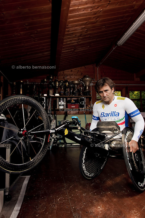 """Padova, Alex Zanardi. Alessandro """"Alex"""" Zanardi (Italian pronunciation: [ˈaleks dzaˈnardi]; born 23 October 1966) is an Italian racing driver and paracyclist.<br /> He won two CART championship titles in North America during the late 1990s. He also had a less successful career as a Formula One driver. More recently, he has attracted widespread praise for his return to competition in the aftermath of a crash in 2001 that resulted in the amputation of his legs. He returned to racing less than two years after the accident, competing in the FIA World Touring Car Championship for BMW Team Italy-Spain between 2003 and 2009.<br /> Switching sports, Zanardi took up competition in handbiking, a form of paralympic cycling, with the stated goal of representing Italy at the 2012 Summer Paralympics. In September 2011, Zanardi won his first senior international handbiking medal, the silver medal in the H4 (handbike) category time trial at the UCI World Road Para-Cycling Championships.[1] In September 2012 he won gold medals at the London Paralympics in the individual H4 time trial and the individual H4 road race,[2][3][4] followed by a silver medal in the mixed H1-4 team relay.<br /> On 11 September 2012 he was included by International Paralympic Committee into the London 2012: Top 12 performances list.[5]"""