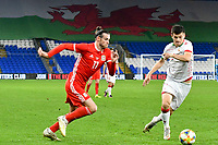 Football - 2019 / 2020 International Friendly - Wales vs. Belarus<br /> <br /> Gareth Bale of Wales on the attack in front of giant welsh dragon flag , at Cardiff City Stadium.<br /> <br /> COLORSPORT/WINSTON BYNORTH
