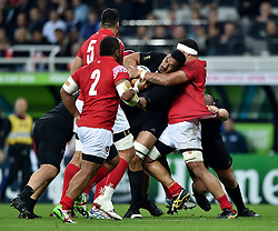 Jerome Kaino of New Zealand is tackled in possession - Mandatory byline: Patrick Khachfe/JMP - 07966 386802 - 09/10/2015 - RUGBY UNION - St James' Park - Newcastle, England - New Zealand v Tonga - Rugby World Cup 2015 Pool C.