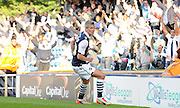 Steve Morrison moments after increasing Millwall's lead during the Sky Bet League 1 match between Millwall and Rochdale at The Den, London, England on 26 September 2015. Photo by Michael Hulf.