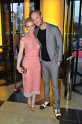 EMILIA FOX and JACK FOX at a VIP preview of the V&A's new exhibition 'The Glamour of Italian Fashion' - a comprehensive look at Italian Fashion from 1945-2014 held at The Victoria & Albert Museum, London on 2nd April 2014.