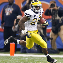 January 3, 2012; New Orleans, LA, USA; Michigan Wolverines running back Fitzgerald Toussaint (28) against the Virginia Tech Hokies during the Sugar Bowl at the Mercedes-Benz Superdome. Michigan defeated Virginia 23-20 in overtime. Mandatory Credit: Derick E. Hingle-US PRESSWIRE