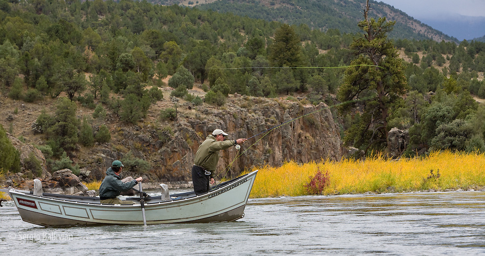 A dory float-fishing trip on the Upper Colorado River in Fall near Kremling, Colorado.
