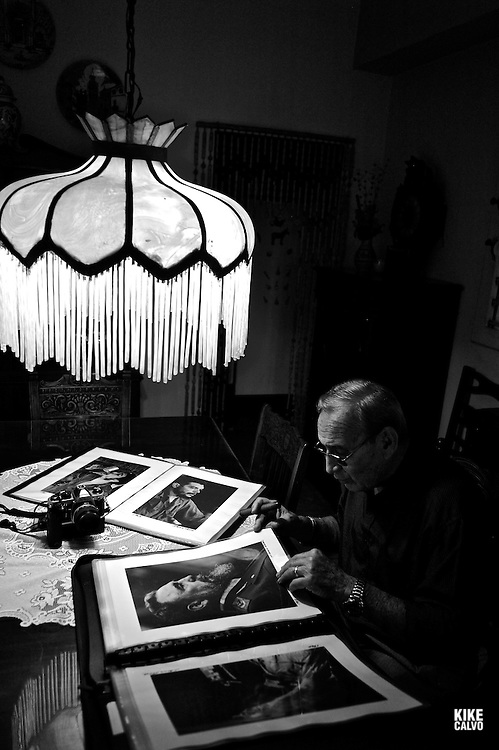 Cuban photographer Liborio Noval (1936-2012), holding a photograph of Fidel Castro smoking a cigar, was one of the most iconic photographers of the Cuban Revolution, at his home in Havana. Died in 2012.