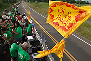 "Long before the Obama campaign adopted the slogan ""Yes we can"", it was a slogan of the farmworker rights movement. Here, a column of marchers heads towards Lakeland, Fl, demanding that the Publix supermarket chain join the Fair Food movement."