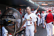 ST. LOUIS, MO - JUNE 30: Carlos Beltran #3 of the St. Louis Cardinals cools down in front of a spray fan during the game against the Pittsburgh Pirates at Busch Stadium on June 30, 2012 in St. Louis, Missouri. The Pirates won 7-3 as temperatures reached 103 degrees during the game. (Photo by Joe Robbins)