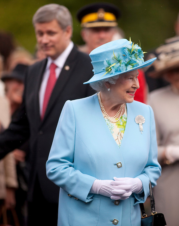 Queen Elizabeth smiles at well wishers during a garden reception at Rideau Hall, the Queen's official residence in Ottawa, Canada, June 30, 2010. The Queen is on a 9 day visit to Canada. <br /> AFP/GEOFF ROBINS/STR