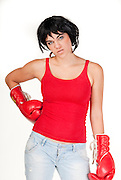 Female boxer wearing a red shirts and red handshoes, isolated in white