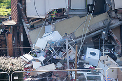 © Licensed to London News Pictures. 24/02/2019. Bristol, UK. A house explosion in Whitchurch Lane, Hartcliffe. Three people received minor injuries and were taken to hospital and much of the house was destroyed. It is reported that it may have been a gas boiler explosion. Photo credit: Simon Chapman/LNP