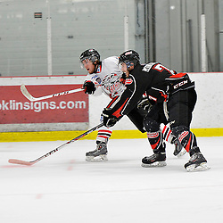 """FORT FRANCES, ON - May 2, 2015 : Central Canadian Junior """"A"""" Championship, game action between the Fort Frances Lakers and the Soo Thunderbirds, Championship game of the Dudley Hewitt Cup. A Soo Thunderbirds player and Nick Minerva #7 of the Fort Frances Lakers follow the shot during the third period.<br /> (Photo by Shawn Muir / OJHL Images)"""