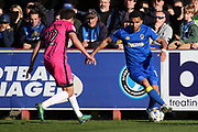 AFC Wimbledon striker Andy Barcham (17) taking on Southend United midfielder Will Atkinson (12) during the EFL Sky Bet League 1 match between AFC Wimbledon and Southend United at the Cherry Red Records Stadium, Kingston, England on 25 March 2017. Photo by Matthew Redman.