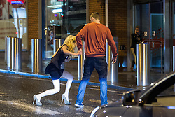 """© Licensed to London News Pictures . 15/12/2012 . Manchester , UK . A woman stumbles and falls in the street . Revellers enjoy a wet but busy night out on one of the last weekends before Christmas , a traditionally busy time when office parties and clubbers decent on bars and clubs , often known as """" Mad Friday """" . Photo credit : Joel Goodman/LNP"""