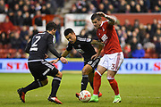 Nottingham Forest Daniel Pinilos (3) battles with Brentford defender Maxime Colin (2) and Brentford midfielder Nico Yennaris (8) during of the EFL Sky Bet Championship match between Nottingham Forest and Brentford at the City Ground, Nottingham, England on 7 March 2017. Photo by Jon Hobley.