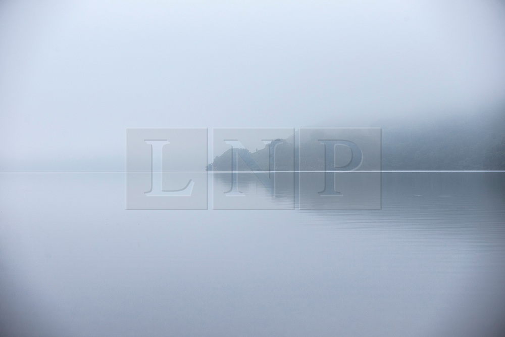 © Licensed to London News Pictures. 14/09/2016. Glenridding UK. Picture shows Ullswater Lake in the morning mist at Glenridding this morning. After last nights thunderstorms in the north of England Cumbria woke to a calm but misty morning. Photo credit: Andrew McCaren/LNP