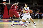 DALLAS, TX - NOVEMBER 25: Nic Moore #11 of the SMU Mustangs brings the ball up court against the Arkansas Razorbacks on November 25, 2014 at Moody Coliseum in Dallas, Texas.  (Photo by Cooper Neill/Getty Images) *** Local Caption *** Nic Moore