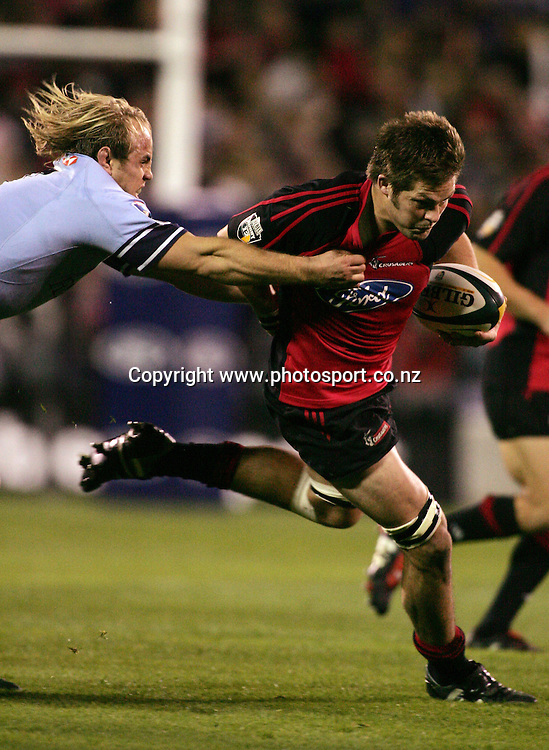 Ritchie McCaw fends off Phil Waugh during the Rebel Sport Super 12 final match between the Crusaders and the Waratahs at Jade Stadium, Christchurch, New Zealand on Saturday 28 May, 2005. The Crusaders won the final 35 - 25. Photo: Hannah Johnston/PHOTOSPORT