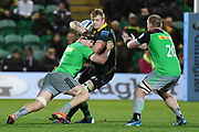 Northampton Saints centre Fraser Dingwall (22) is tackled during the Gallagher Premiership Rugby match between Northampton Saints and Harlequins at Franklins Gardens, Northampton, United Kingdom on 1 November 2019.