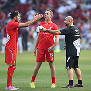 Emre Can, (left), and Jordan Henderson, (centre), during warm up before the Liverpool Vs AS Roma friendly pre season football match at Fenway Park, Boston. USA. 23rd July 2014. Photo Tim Clayton