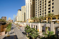 View along The Walk shopping and eating street at Jumeirah Beach Residences (JBR) in marina district of Dubai United Arab Emirates