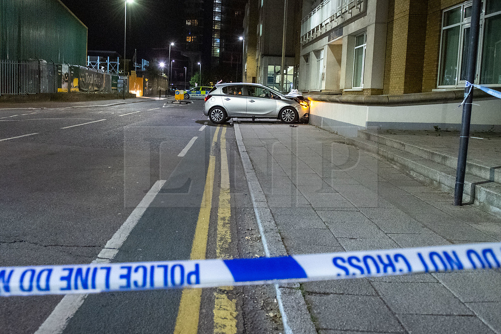 © Licensed to London News Pictures. 13/05/2020. London, UK. Police tape marks a cordon in front of a vehicle that has collided with a wall on Lombard Street. Police were called at around 1800BST on Wednesday, 13 May, to reports of a man with a knife in Lombard Road, SW11. There were also reports of a car in collision with a wall in Lombard Road. Officers attended the location and found two men injured - one had cuts to his arms and the other cuts to his legs. Officers believed the two men had been travelling in the car. Both have been taken to hospital, where their injuries are not believed to be life-threatening. Investigations at the scene led officers to Vicarage Crescent, SW11, where they found two other injured men. Both were taken to hospital with non life-threatening injuries. Photo credit: Peter Manning/LNP
