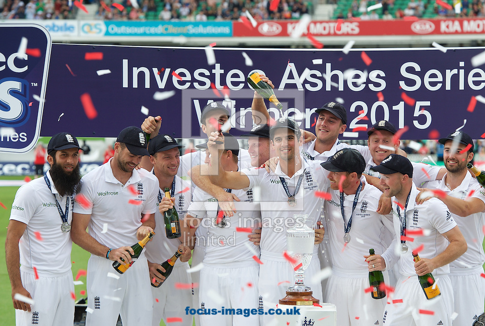 Captain Alastair Cook of England holds the Ashes Trophy aloft after winning the series in the 5th Investec Ashes Test match at the Kia Oval, London<br /> Picture by Alan Stanford/Focus Images Ltd +44 7915 056117<br /> 23/08/2015