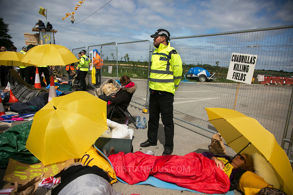 13 local activists locked themselves in specially made arm tubes to block the entrance to Quadrilla's drill site in New Preston Road, July 03 2017, Lancashire, United Kingdom. Activists, protectors and supports. The 13 activists included 3 councillors; Julie Brickles, Miranda Cox and Gina Dowding and Nick Danby, Martin Porter, Jeanette Porter,  Michelle Martin, Louise Robinson,<br /> Alana McCullough, Nick Sheldrick, Cath Robinson, Barbara Cookson, Dan Huxley-Blyth. The blockade is a repsonse to the emmidiate drilling for shale gas, fracking, by the fracking company Quadrilla. Lancashire voted against permitting fracking but was over ruled by the conservative central Government. All the activists have been active in the struggle against fracking for years but this is their first direct action of peacefull protesting. Fracking is a highly contested way of extracting gas, it is risky to extract and damaging to the environment and is banned in parts of Europe . Lancashire has in the past experienced earth quakes blamed on fracking.