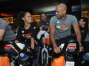 Misty Copeland and Olu Evans ride at a 2016 Cycle for Survival event at Equinox Bryant Park in New York, Sunday, March 13, 2016. Cycle for Survival is the national movement to beat rare cancers. 100 percent of funds raised go directly to rare cancer research led by Memorial Sloan Kettering. More than $100 million has been raised since the first ride ten years ago, thanks to support from founding partner Equinox. For more information, visit www.cycleforsurvival.org. (Diane Bondareff/AP Images for Cycle for Survival)