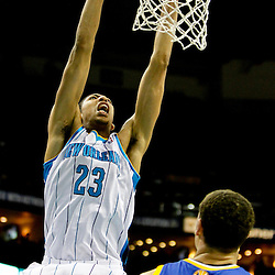Jan 19, 2013; New Orleans, LA, USA; New Orleans Hornets power forward Anthony Davis (23) dunks over Golden State Warriors shooting guard Klay Thompson (11) during  the second quarter of a game at the New Orleans Arena. Mandatory Credit: Derick E. Hingle-USA TODAY Sports