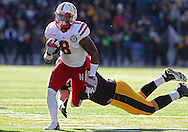 November 23 2012: Iowa Hawkeyes defensive lineman Louis Trinca-Pasat (90) can't grab Nebraska Cornhuskers running back Ameer Abdullah (8) on a run during the first half of the NCAA football game between the Nebraska Cornhuskers and the Iowa Hawkeyes at Kinnick Stadium in Iowa City, Iowa on Friday November 23, 2012. Nebraska defeated Iowa 13-7 in the Heroes Game on Black Friday.