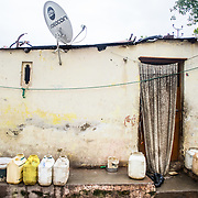 CAPTION: More and more slum households have access to television, mobile phones and so on, but access to essential services such as clean water and garbage disposal still remains a concern. LOCATION: Chikitsak Nagar, Indore, Madhya Pradesh, India. INDIVIDUAL(S) PHOTOGRAPHED: N/A.