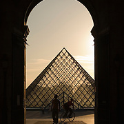 Pyramid at the Musee du Louvre at sunset, Paris France<br />