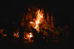 September 7, 2017 - Klang, Kuala Lumpur, Malaysia - Malaysian Chinese people burn a giant paper statue of Chinese deity ''Da Shi Ye'' or ''Guardian God of Ghosts'' is burnt during the Chinese Hungry Ghost Festival. (Credit Image: © Kepy via ZUMA Wire)