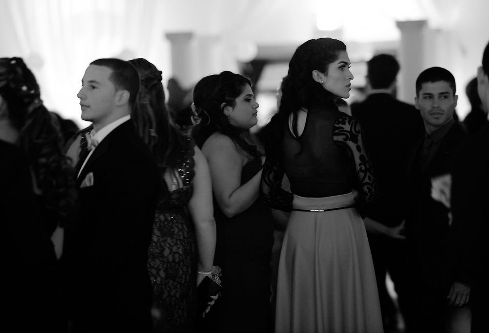 Ariel Zavala, right, nervously looks over her shoulder while at her prom Saturday, April 30, 2016 in Tampa. Zavala who is transitioning from male to female attended her prom for Alonso High School on Saturday. CHRIS URSO/STAFF